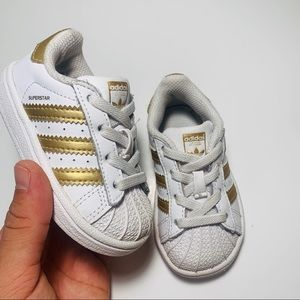 Used adidas low top baby 👶 size 5k gold/ white
